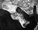 Straight down aerial view of the Pearl Harbor submarine base, 22 Aug 1941. The large C-shaped building is Fleet Headquarters where Admiral Kimmel's office was. Note some of the fuel storage tanks are camouflage painted