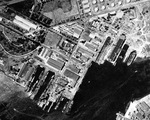 Straight down aerial view of the Pearl Harbor Navy Yard and drydocks, 16 Oct 1941. There are two battleships at the Navy Yard piers. Note Drydock #2 still under construction.