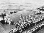 Burial at sea services aboard USS Lexington (Essex-class) following action around Palau, 2 Apr 1944.