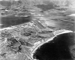 Aerial view of Naval Air Station Kaneohe, Oahu, Hawaii with Kaneohe Bay seen beyond the airstrip, Jun 1944.