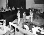 Japanese Naval Lieutenant (junior grade) Yoshinum Yoshihau hears the verdict of the War Crimes Commission on Guam, Mariana Islands, headed by Rear Admiral A.G. Robinson, 14 Nov 1946.