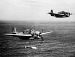 A training flight of TBF-1 Avengers lining up to drop practice torpedoes, late 1942, off the east coast of the United States. Photo 4 of 4.