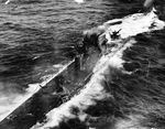 The decks and conning tower of U-175 after being forced to the surface by depth charges from Coast Guard cutter Spencer just before U-175 sank, North Atlantic, 500 nautical miles WSW of Ireland, 17 Apr 1943.