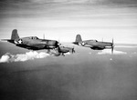 Four F4U Corsair fighters practicing aerial maneuvers, Mar-May 1943; probably stateside training. Photo 1 of 2.
