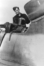 An armorer loading 13mm ammunition into the twin Rheinmetall MG131 guns in the upper fuselage of a Focke Wulf Fw-190A of Fighter Wing One (Jagdgeschwader 1), probably in France, circa 1944.