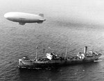 United States Navy K-class airship K-28 of Blimp Squadron 14 during escort duty above the armed tanker SS Paulsboro about 80 miles off the mouth of Chesapeake Bay, Virginia, United States, 27 Jan 1944.