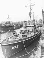 United States Coast Guard cutter WPC-372 in New York Harbor, spring 1942. Note Mousetrap anti-submarine rocket rails on her foredeck. Photo 2 of 3.