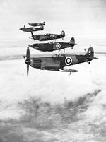 Six Spitfire Mark I's of No. 19 Squadron, Royal Air Force, based at Duxford, Cambridgeshire, England flying in starboard echelon formation led by the Commanding Officer, Squadron Leader H.I. Cozens, 1938.