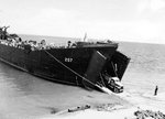 United States Navy ship LST-207, staffed by Coast Guard personnel, on Kukum Beach, Guadalcanal, Solomon Islands, 26 Nov 1943.