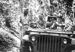 General Joseph Stilwell holding a roadside conference with Brigadier General Lewis Pick whose engineers were instrumental in the completion of the Burma Road, Burma, 1944.