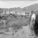 A former internee looking at a building of the Stanley Interment Camp, Hong Kong, 18 Sep 1945