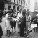 Recently freed internees of Stanley Internment Camp purchasing newspapers, Hong Kong, 12 Sep 1945