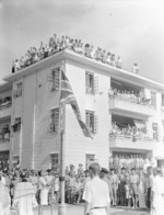 Flag raising ceremony, Stanley Internment Camp, Hong Kong, 30 Aug 1945