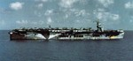Escort carrier USS Santee in Oct 1942, probably in Bermuda, preparing to cross the Atlantic for the Operation Torch landings in North Africa. Note SBD Dauntless, F4F Wildcat, and TBF Avenger aircraft on the flight deck.
