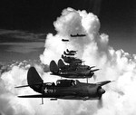 Curtiss SB2C Helldiver dive bombers of Bombing Squadron 17 on a training flight in the eastern United States, 26 Jun 1943.  Three weeks later, this squadron would deploy aboard USS Bunker Hill.