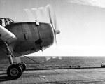 TBF Avenger running up its engines before launching from escort carrier USS Santee in the Atlantic, Nov 1943. Note the catapult bridle attached to the landing gear.