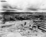 Ships at Pearl Harbor's repair piers, 16 Jan 1944. Note the camouflage paint on the buildings.