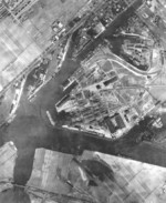 Aerial view of Nordseewerke Emden shipyard, Emden, Germany, 1942; note Slips I through V in center