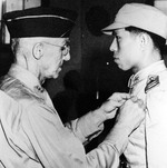 Lieutenant General Joseph Stilwell awarding the Silver Star to Chinese pilot Captain Tsang Hsi-lan for actions in the air during the Battle of Changsha, early 1942.