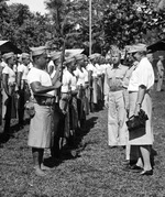 "First Lady Eleanor Roosevelt inspecting ""native"" Samoan Marines at Tutuila, Samoa, 23 Aug 1943. Also present are United States Marine MGen C.F.B. Price, Commanding General of the area and Captain John R. Napton, Jr."