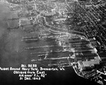 Aerial view of Puget Sound Naval Shipyard, 31 Dec 1943. Note the carrier USS Lexington (Essex-class) in drydock in the center of the photo.