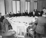 The conference table for the Yalta Conference, Feb 1945. Note Stalin, Roosevelt, and Churchill along with other officials seated around the table.