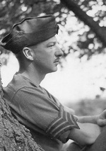 Sergeant John Morris of the British Army Film and Photographic Unit relaxing in Africa, late 1942.