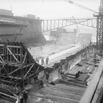Early construction of a large concrete caisson known as a Phoenix, 27 Jan 1944 in southern England. These had flooding valves and were to be sunk as part of the Mulberry Harbors for the Normandy landings.