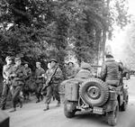 Shortly after arriving in Normandy, France, General Bernard Montgomery's Jeep stopped so he could examine German prisoners being marched toward the beach, 8 Jun 1944.
