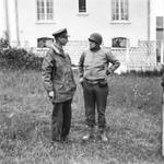 Generals Omar Bradley and Miles Dempsey at a meeting in the field in Port-en-Bessin, France during the Normandy campaign, 10 Jun 1944.