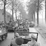 During their tour of the assault on the Rhine, British Prime Minister Winston Churchill and Field Marshal Bernard Montgomery stopped their Jeeps to allow troops to pass in troop carriers, 26 Mar 1945.