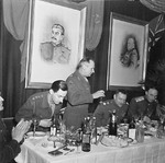 British Field Marshal Bernard Montgomery stands to propose a toast during a dinner at the headquarters of Soviet General Konstantin Rokossovsky in Wismar, Germany, 7 May 1945.
