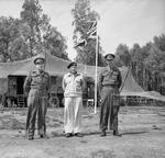Generals Henry (Harry) Crerar and Miles Dempsey flank Field Marshal Bernard Montgomery at Montgomery's headquarters at Lüneburg Heath, Germany, 10 May 1945.