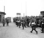 The British Army entering the Bergen-Belsen Concentration Camp 15 Apr 1945 as German and Hungarian guards man the gate. On the right is a loudspeaker truck to inform inmates the camp was under British authority.