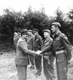 British Secretary of State for War, Sir James Grigg, greeting Eighth Corps senior officers at Corps headquarters in Normandy, France during a tour of the forward areas, 16 Aug 1944.