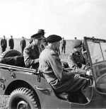 King George VI of the United Kingdom and Field Marshal Bernard Montgomery in a Jeep in the Netherlands, 12 Oct 1944.