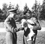 "King George VI of the United Kingdom, Field Marshal Bernard Montgomery, and Montgomery's fox terrier puppy named ""Hitler"" at Montgomery's headquarters in the Netherlands, 15 Oct 1944."