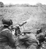 Machine gunners of the 1st Battalion, Middlesex Regiment, firing the Vickers machine gun in support of the 6th Royal Scots Fusiliers between Meijel and Liessel, Netherlands, 1 Nov 1944.