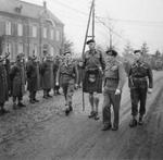 Field Marshal Bernard Montgomery and Major General Colin Muir Barber inspecting the 15th Scottish Division, 12 Dec 1944. At 6-feet, 9-inches, Barber was considered the tallest officer in the British Army.