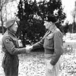 Field Marshal Bernard Montgomery (right) congratulating Victoria Cross recipient Sgt George Eardley, 2 Jan 1945. Sgt Eardley received the Victoria Cross for extreme heroism east of Overloon, Netherlands on 16 Oct 1944.