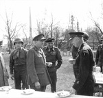 Chief of the Imperial General Staff Field Marshal Alan Brooke, Field Marshal Bernard Montgomery, and Supreme Allied Commander Dwight Eisenhower during an outdoor lunch break, 25 Mar 1945.