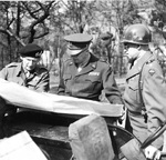 Field Marshal Bernard Montgomery, General Dwight Eisenhower, and General Omar Bradley examining a map on the side of a Jeep in Germany just west of the Rhine, 25 Mar 1945.