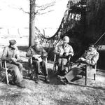 Generals Matthew Ridgway of the US XVIII Airborne Corps, Miles Dempsey of the 2nd British Army, William Simpson of the US 9th Army, and Bernard Montgomery at Dempsey's headquarters, 25 Mar 1945, discussing the recent crossing of the Rhine.