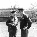 British Prime Minister Winston Churchill and Supreme Allied Commander Dwight Eisenhower in conversation at the American XVI Corps headquarters, 25 Mar 1945. Note M8 Greyhound in background.