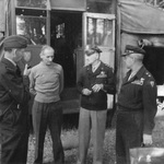 British Air Chief Marshal Arthur Tedder, General Bernard Montgomery, American Lieutenant General Carl Spaatz, and Major General Ralph Royce meeting at Montgomery's headquarters in Blay, Normandy, France, 15 Aug 1944.