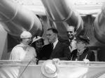 President Franklin Roosevelt (center) under USS Indianapolis' 8-inch guns during the Navy Review, 31 May 1934, New York City, New York, United States. The president's wife, Eleanor, is at left and mother, Sara, at right.