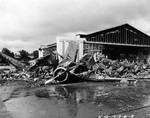Aircraft wreckage on the ramp at Wheeler Field, Oahu, Hawaii, following the air attack of 7 Dec 1941.