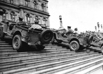 In a public relations event, three Jeeps climb the steps of the State Capitol building, Albany, New York, United States, 15 Apr 1942.
