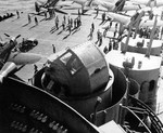 Mk 40 gun director seen from the island's number two quad 40mm gun mount aboard the carrier USS Essex, late 1943. Note SBD Dauntless scout bombers with Bombing Squadron VB-9.