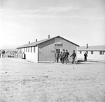 Men entering the cooperative canteen at Granada Relocation Center for deported Japanese-Americans (Camp Amache) in Colorado, United States, 9 Dec 1942.